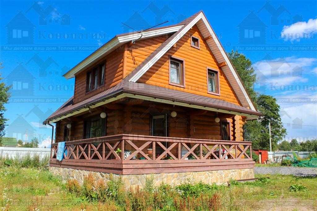 Фото-внешняя конопатка сруба дома ручной рубки в районе Лупполово.