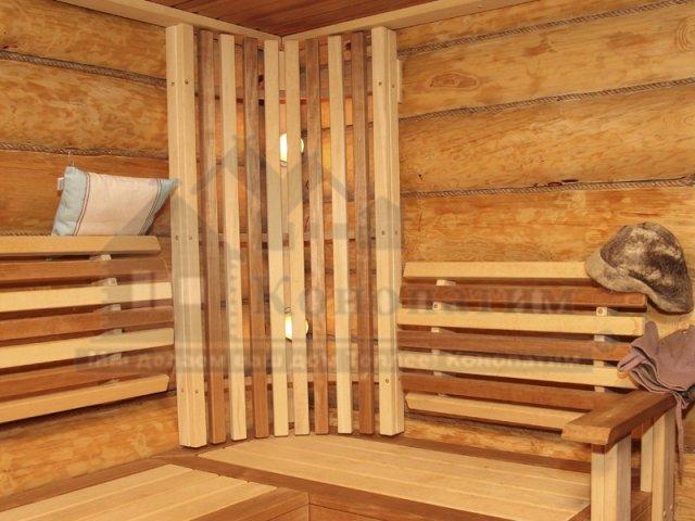 Фото-внутренняя конопатка бани ручной рубки в Симагино. Декоративный канат в интерьере парилки.