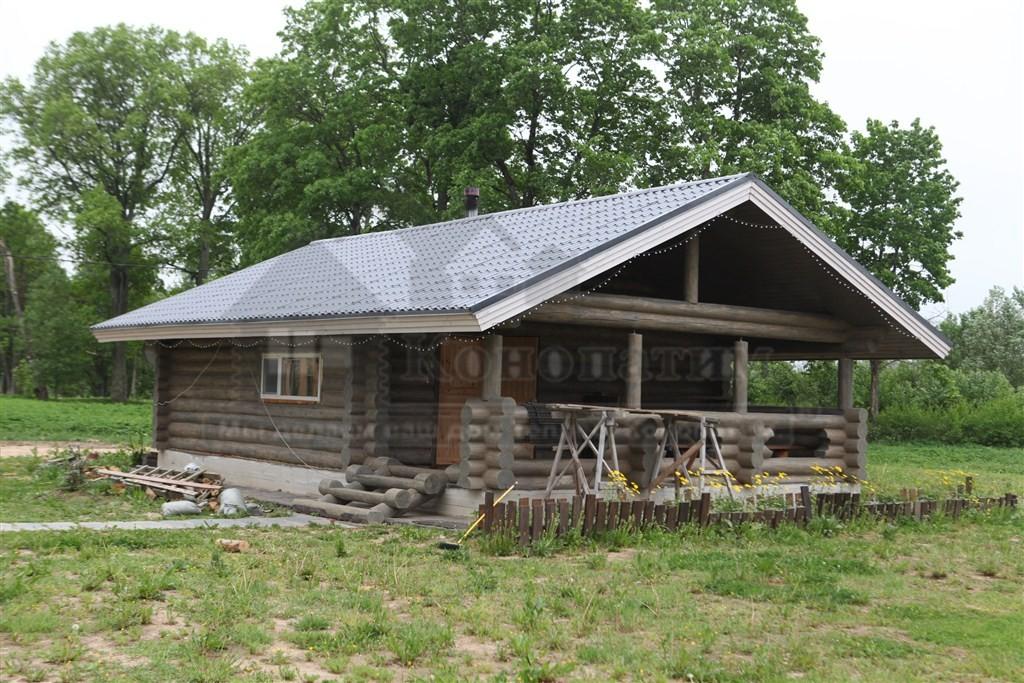 Фото после внешней конопатки сруба дома ручной рубки Раболово.