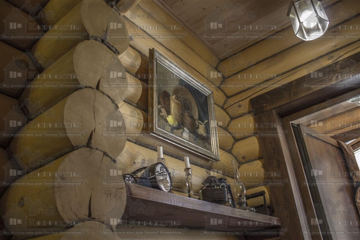 Внутренняя конопатка бревен дома в Заходском.