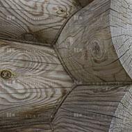 Конопатка оцилиндрованного бревна
